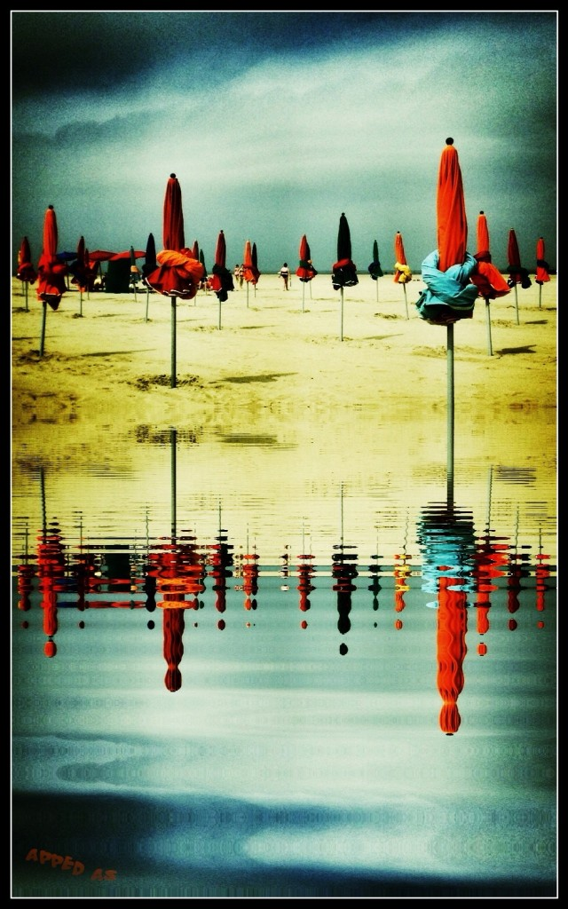 Umbrellas on Deauville's beach Normandy by Leon Williams